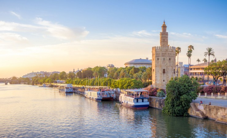 """Torre Del Oro By The Guadalquivir River"""