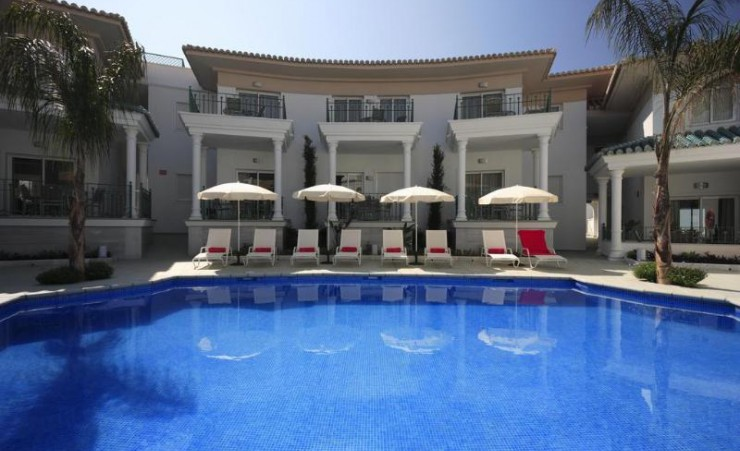 Loungers by Swimming Pool