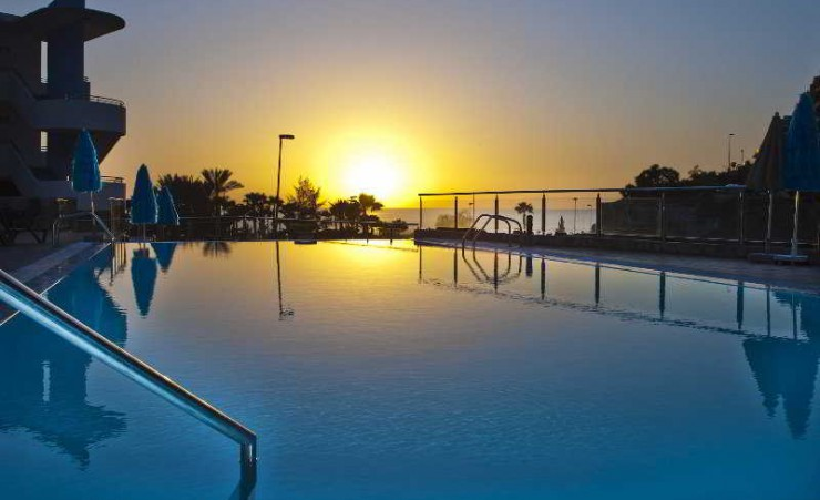 Outdoor Swimming Pool at Sunset