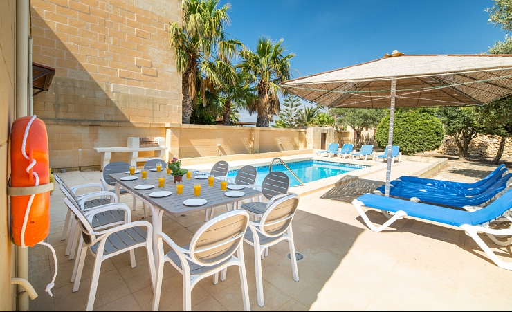 Seating And Sun Loungers By Pool
