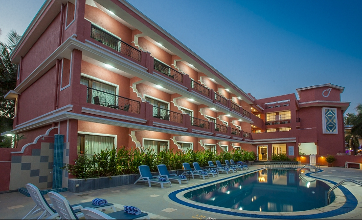 Exterior Of Hotel With Pool