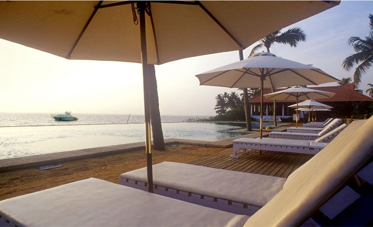 Sunbeds by Infinity Pool